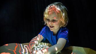 Child enjoying Soundpit at Southbank Centre