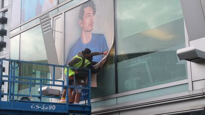 Installing Tom (2020) by Lydia Blakeley, on the windows of Southbank Centre's Liner Building, overlooking Mandela Walkway.