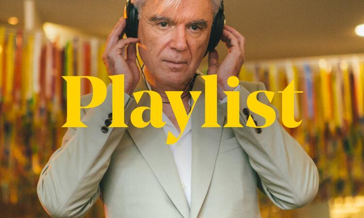 David Byrne listens to music through headphones behind the word 'Playlist'