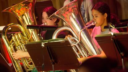 Young musicians playing a tuba