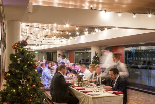 Christmas party. People enjoying festive food and drinks