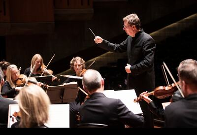 Orchestra and conductor performing