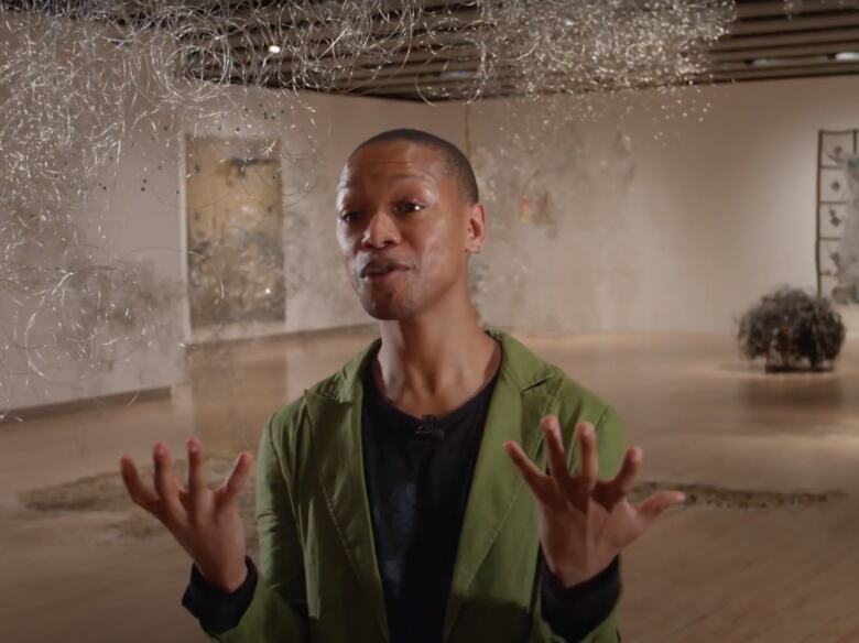 Nakhane talks expressively to camera within the exhibition Igshaan Adams: Kicking Dust at Hayward Gallery