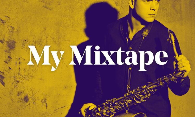 Marius Neset stands with his saxophone