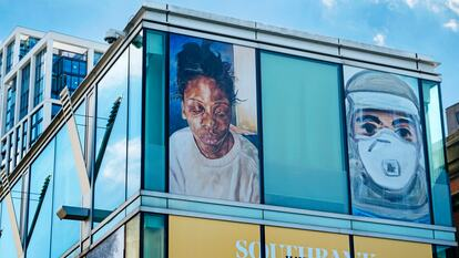 Installation view of Barbara Walker, Attitude (1998) and Matthew Krishanu, Hospital Chaplain – Face Mask (Rehanah Sadiq) (2020) at Southbank Centre's Everyday Heroes exhibition