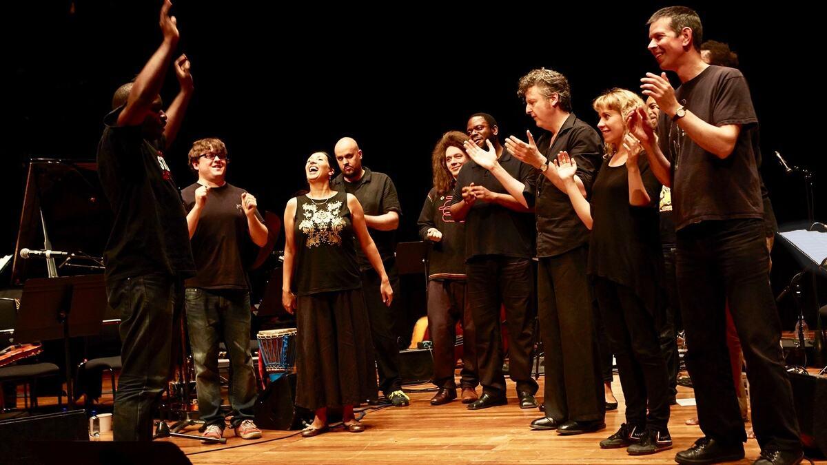 Jason Yarde and musicians celebrating on stage