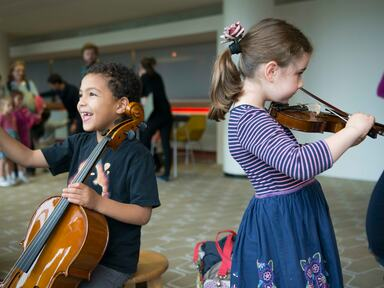 Children playing instruments at the FUNharmonics Event