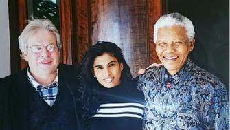 John Battersby and Nelson Mandela pose together with another friend for a photograph
