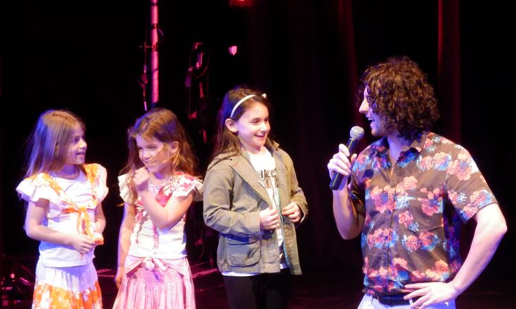 Performer and kids on stage