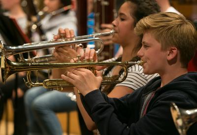 Close-up of a young musician in orchestra