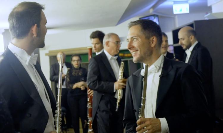 Flautist Manfred Ludwig chats with a fellow musician backstage at the Gewandhaus, Leipzig