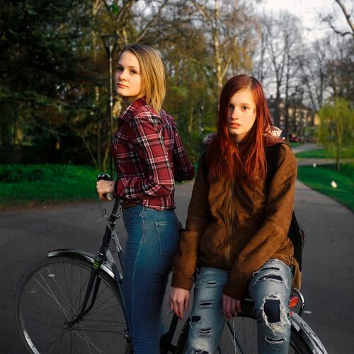 Carlos Alba's submission for 'Inspired by Arbus' photography competition run by Southbank Centre with UAL. The photograph depicts two teenage women on a bicycle in a park.