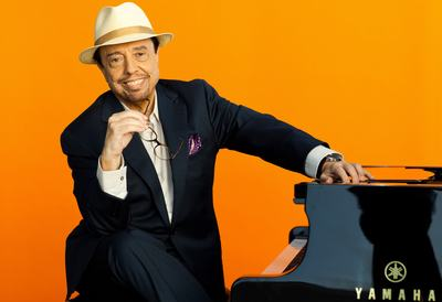 Sergio Mendes sat at the piano