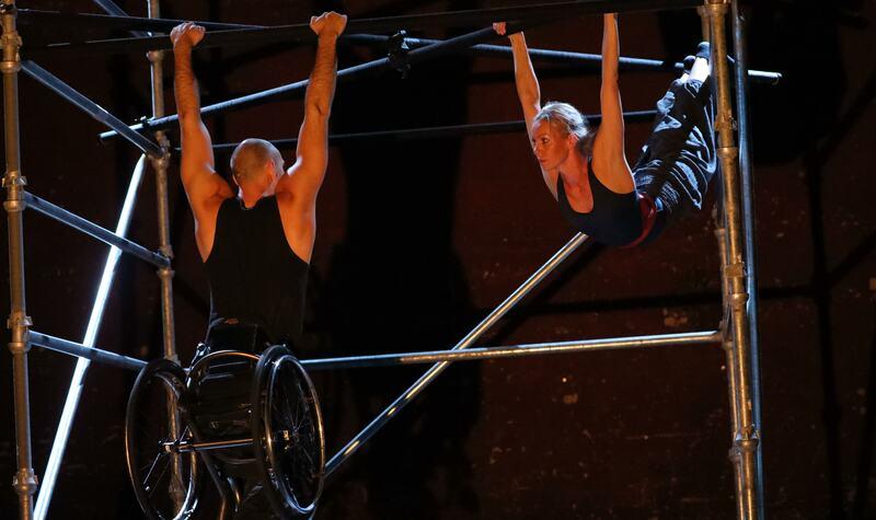 Two dancers Eva Mutso and Joel Brown performing a duet