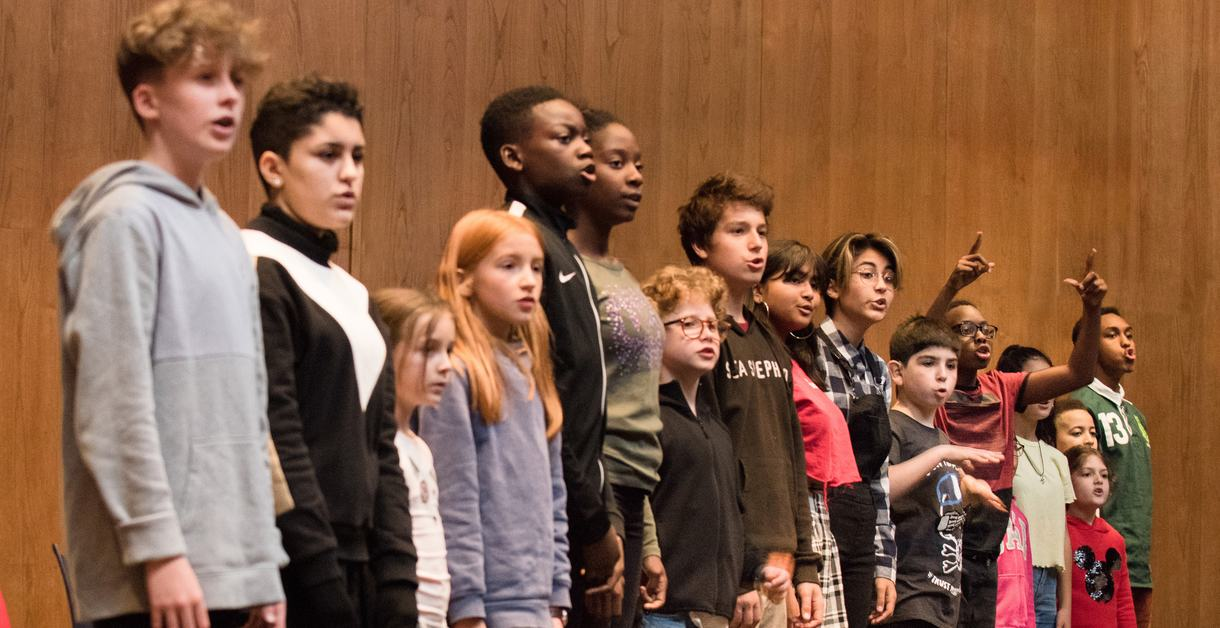 The cast of children standing in a line