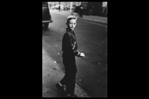 Boy stepping off the curb, N.Y.C. The 1957-58 photograph by Diane Arbus depicting a boy stepping off a sidewalk in New York