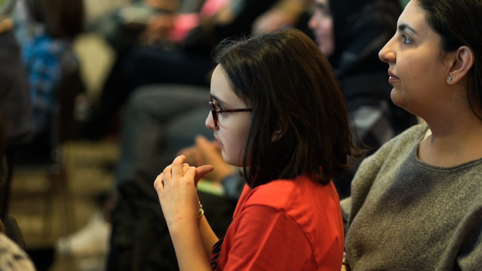 A young person watching a performance