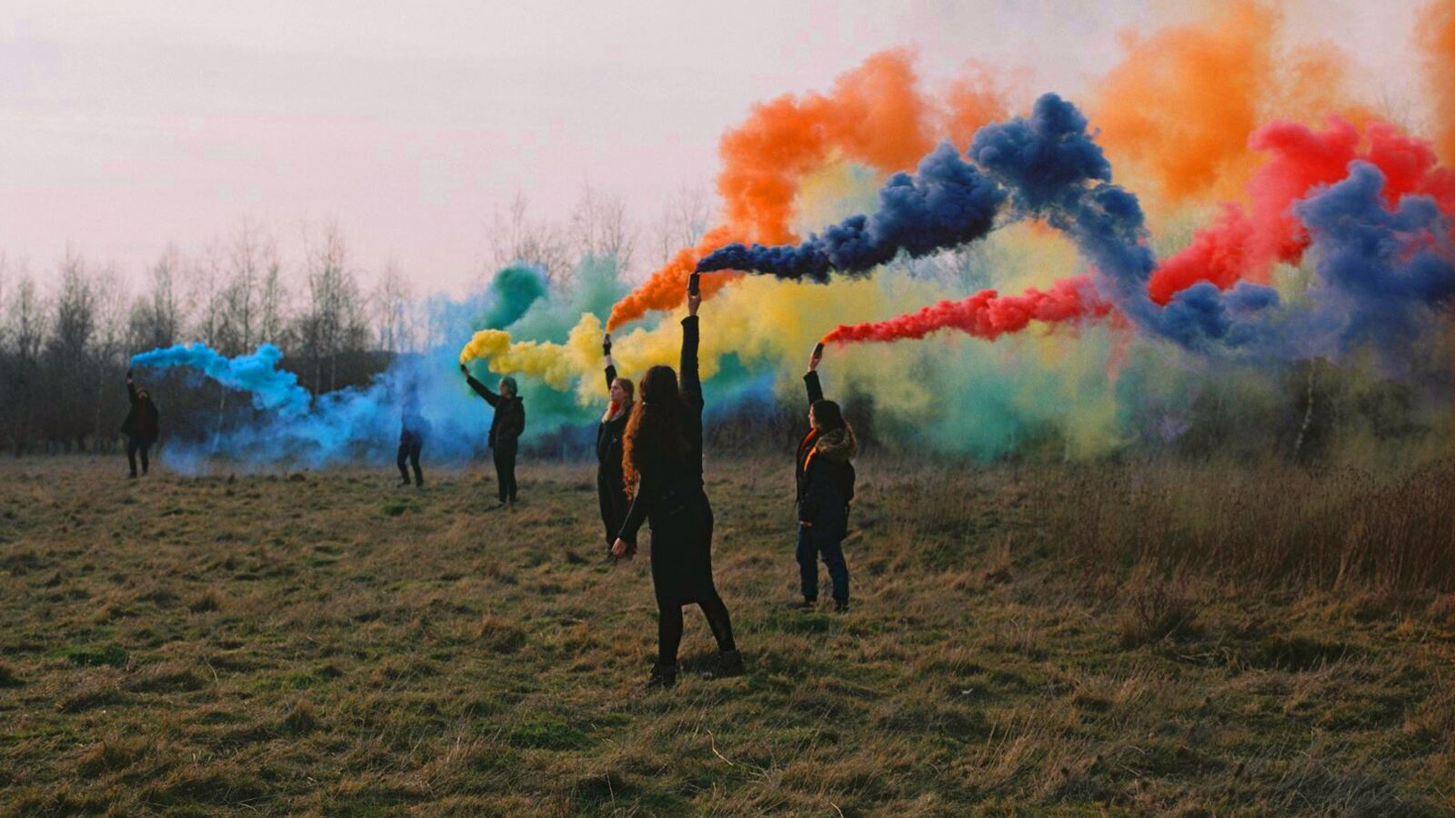 Sisters Uncut set off rainbow-coloured smoke in solidarity with LGBTQ+ migrants during a demonstration in support of detainees at Yarl's Wood Immigration Removal Centre