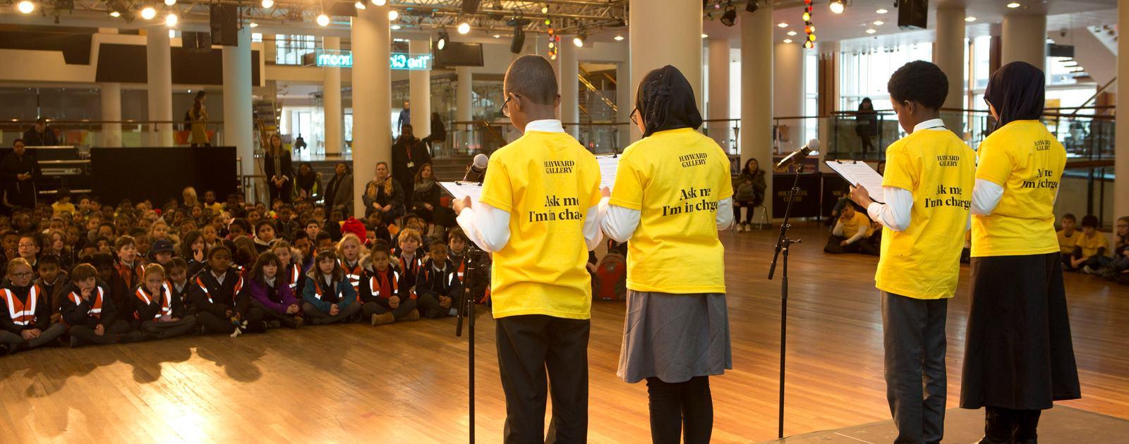 Children reading poetry for school children in Royal Festival Hall