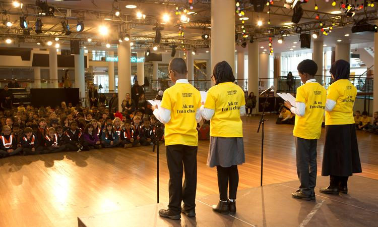 Children reading poetry for school children in Royal Festival Hall