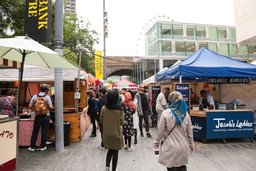 People enjoying the Southbank Centre Food Market