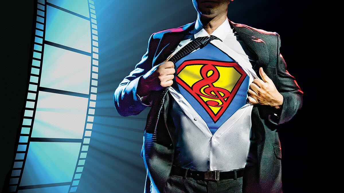 Man revealing Superman costume