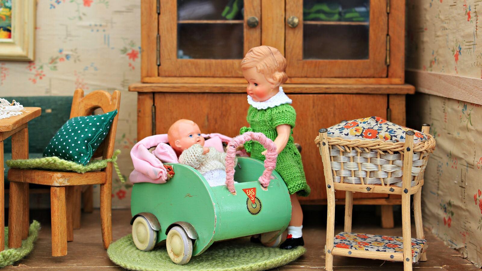 Dolls in a dollhouse