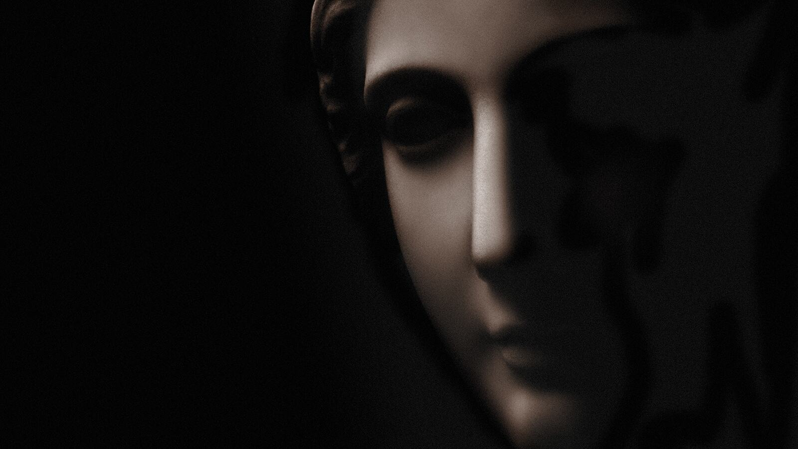 Detail from a classical style memorial statue. Has strong film grain at full size.