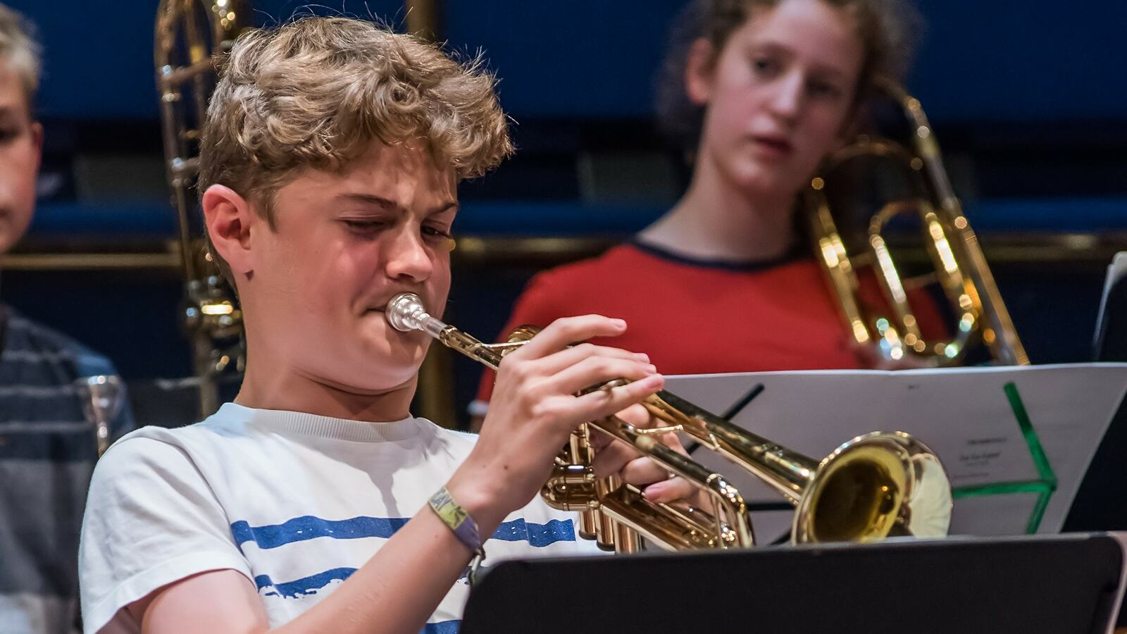 NCO Under 13 Orchestra Winter Concert, boy playing trumpet in an orchestra