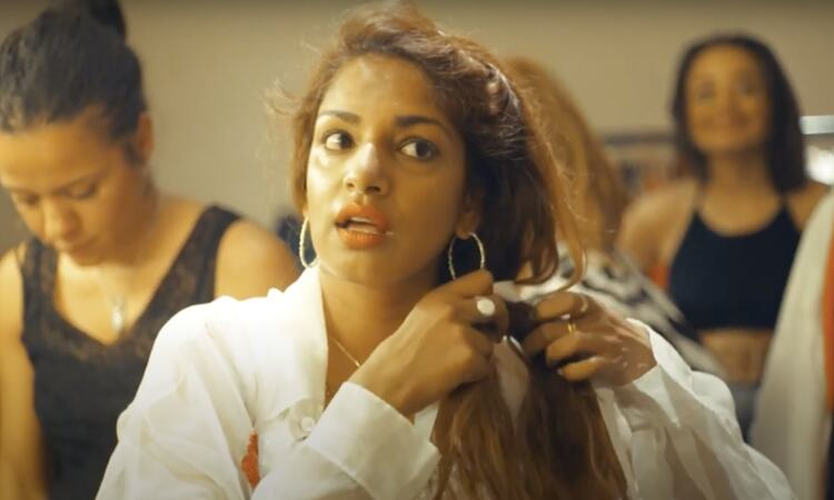 M.I.A. fixes her hair in her dressing room backstage at Southbank Centre's Meltdown festival