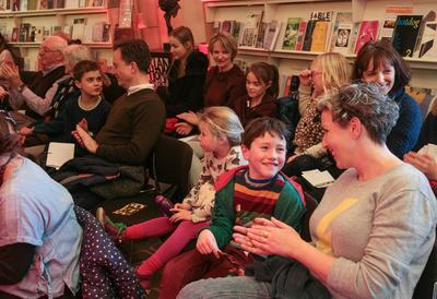 Photo of an audience of children and adults at the National Poetry Library at Southbank Centre