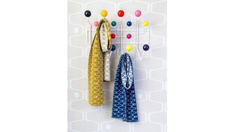 Two Southbank Centre Net & Ball scarfs in yellow and blue hanging on coathooks
