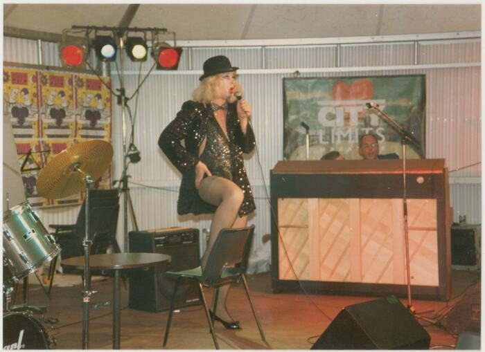 Drag artist David Dales performs in the cabaret tent at Pride '87 Carnival at London South Bank