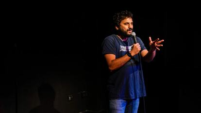 Comedian Nish Kumar performs on stage