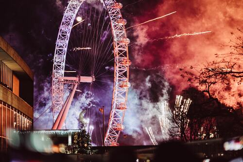 Southbank Centre, views of the London Eye lit up by fireworks on New Year's Eve