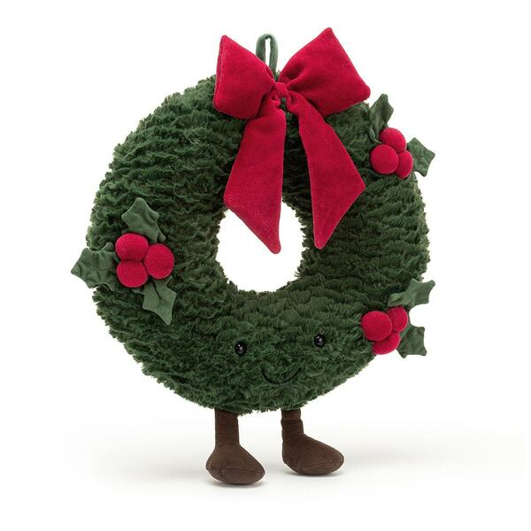 Amuseable Christmas wreath with a dark green ring and three bunches of red holly berry, completed with an endearing red bow