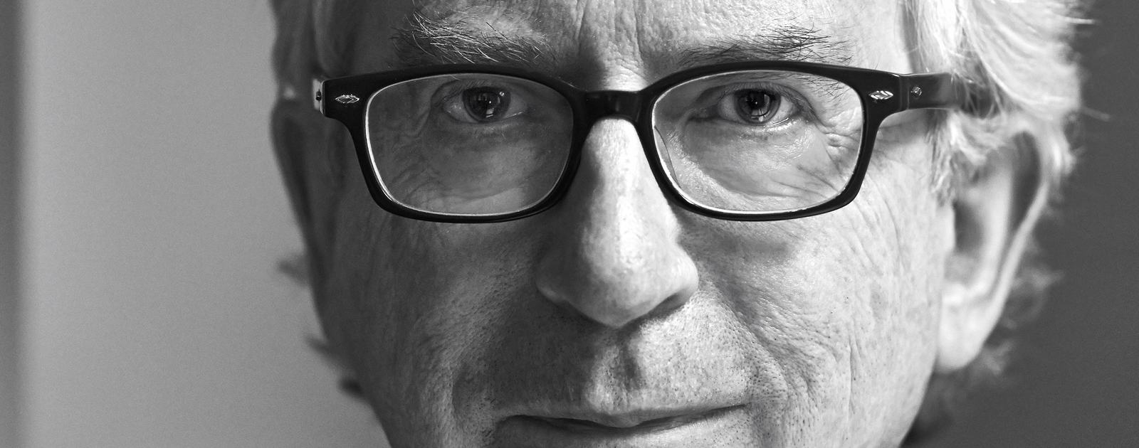 Black & white photo portrait of author Peter Carey at Southbank Centre's ManBooker 50 festival