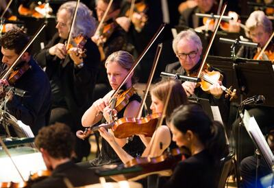 Philharmonia Orchestra Musicians Playing String Instruments