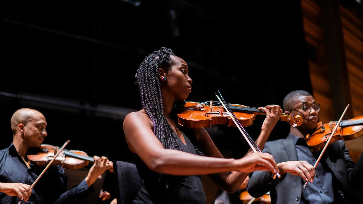 Violinist playing with Chineke! Orchestra