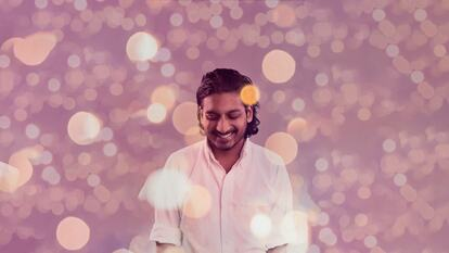 Amir Shah with a purple background
