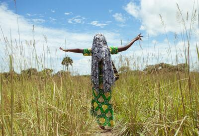 Indigenous woman walking in a field