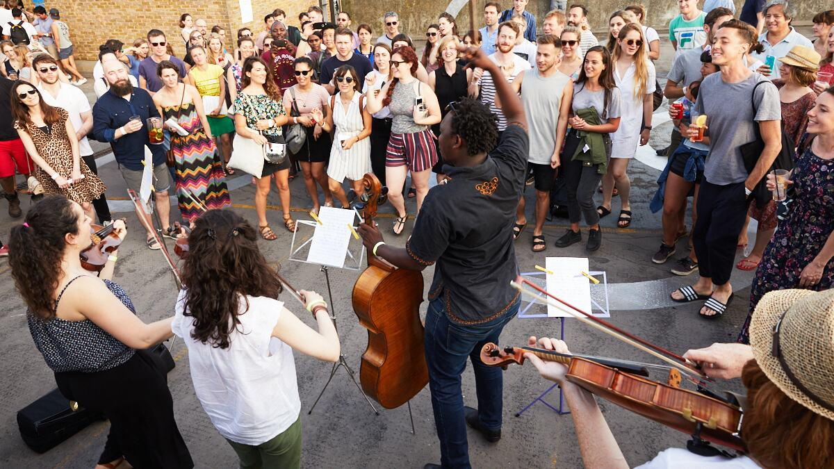 Multistory orchestra performs its Living Notes programme in Kings Cross area.