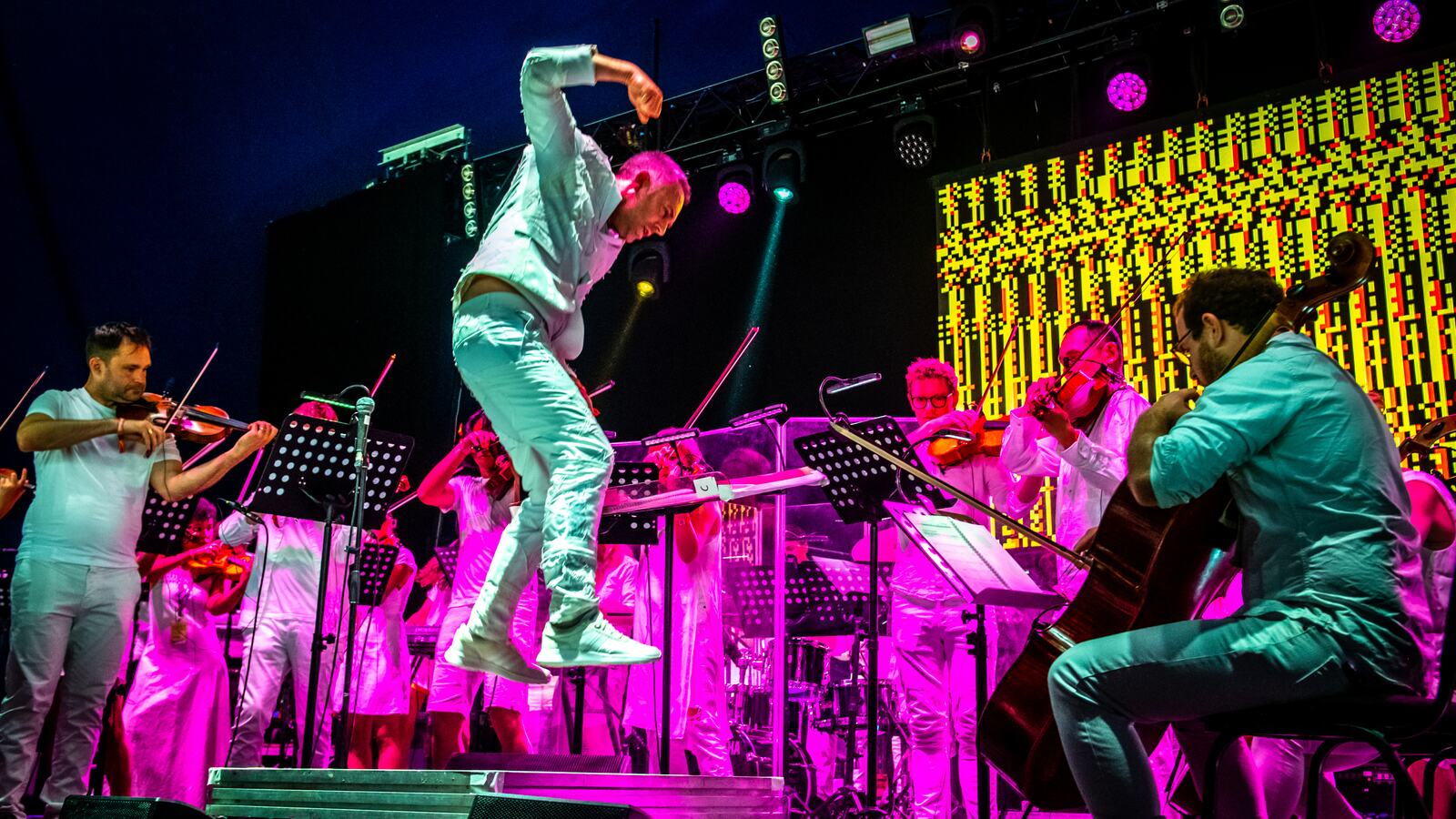 The Love Unlimited Synth Orchestra performing on stage