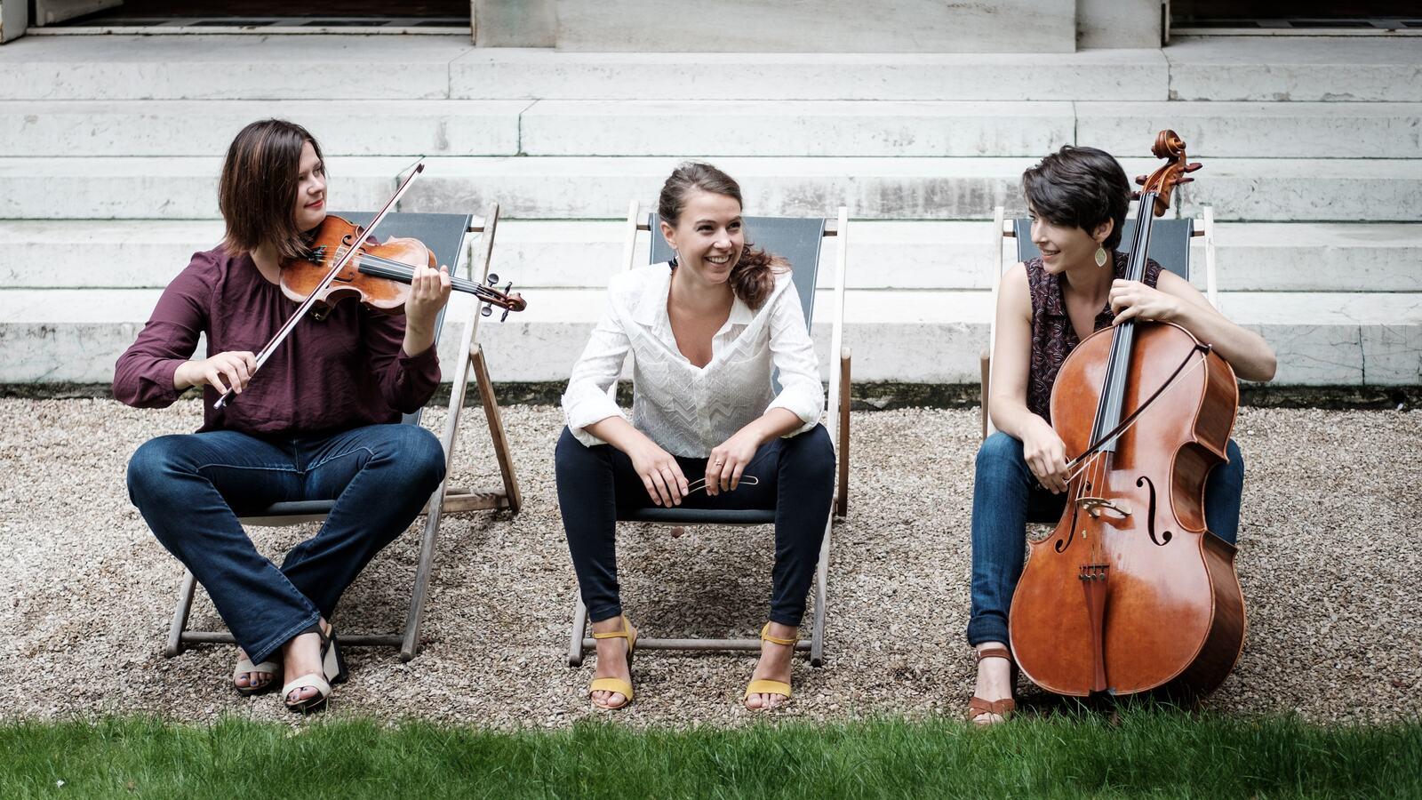 Trio Sora Sitting Casual Holding String Instrument