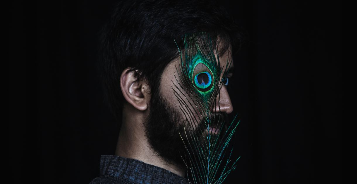 Sarathy Korwar with peacock feather over his eyes