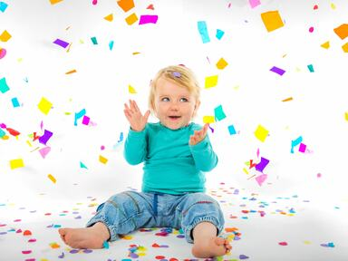 A toddler sits beneath a flurry of confetti in this image depiction of the event Kaleidoscope
