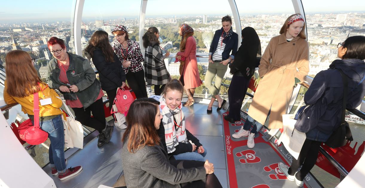 Schhool girls and mentors on the London Eye for International Day of the Girl