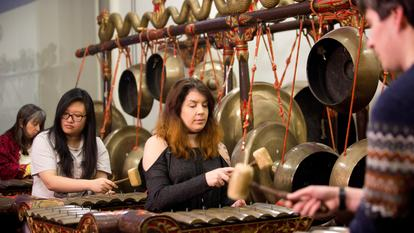 Adults playing Gamelan
