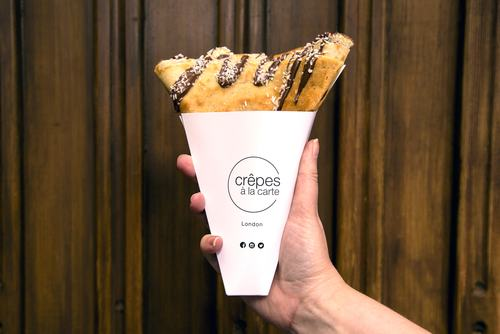 Photo of a banana and nutella crêpe in a takeaway cone served by Crêpes à la carte at Southbank Centre Food Market