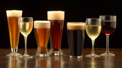 """An assortment of glasses of wine and beer including a classic pilsner flute, a sparkling wine glass, an American half pint glass, a weizen or wheat beer glass, an American pint glass, a white wine glass, and a red wine glass."""
